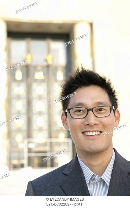 Portrait of a young Asian man wearing glasses