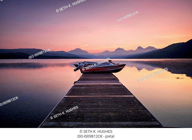 Wooden pier and boat at dawn, Lake McDonald, Glacier National Park, Montana, USA