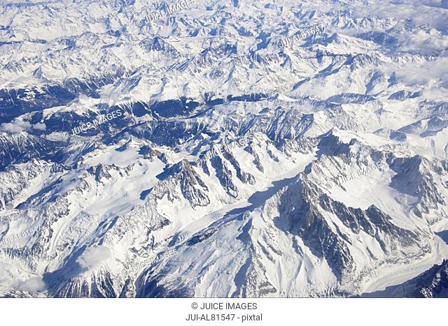 Aerial view of snow covered mountains, Swiss Alps, Switzerland