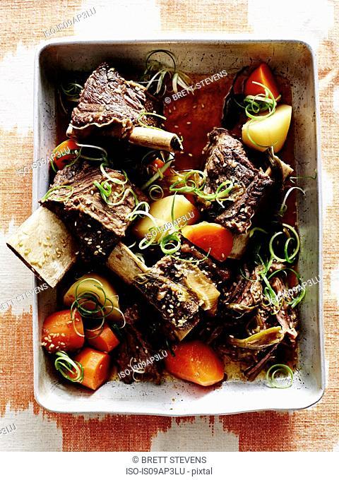 Roasting tin of Korean galbijjim - ribs