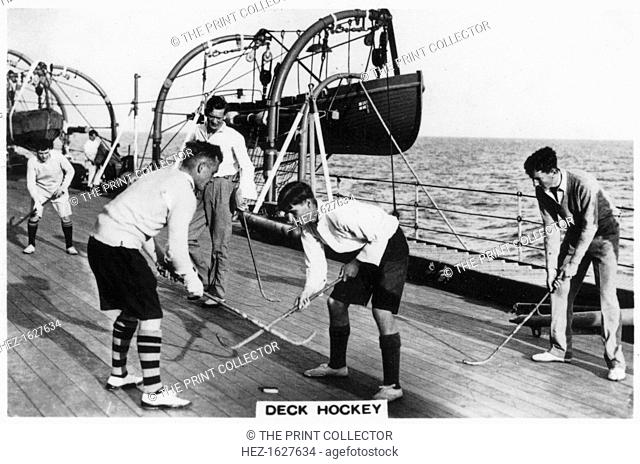 Deck hockey on board the battleship HMS 'Nelson', 1937. Cigarette card from The Navy series, produced by Senior Service Cigarettes, 1937