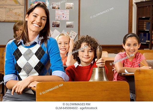 Students with their teacher in a classroom