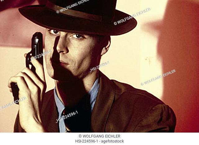social issues, crime, terrorism, gun, man, hat, pistol, handgun, firearm, weapon, portrait, terrorist, criminal, secret agent, outlaw, danger, gangster