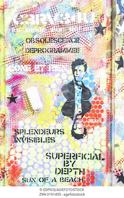 stencil portrait of french poet arthur rimbaud on a graffiti covered wall, paris, ile de france, france