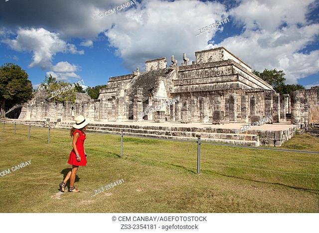 Woman posing near Temple Of the Warriors at Chichen Itza Ruins, Chichen Itza, Yucatan Province, Mexico, Central America