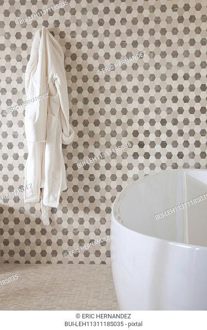 Contemporary bathroom with hanging bathrobe and a cropped bath at home; Irvine; California; USA