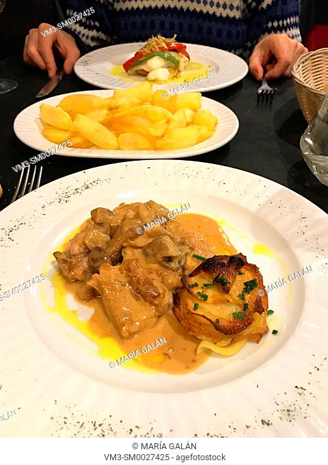 Meat with mushrooms sauce and grilled potatoes