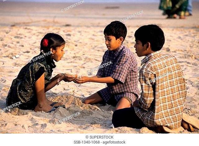 Children playing on the beach, Marina Beach, Chennai, Tamil Nadu, India