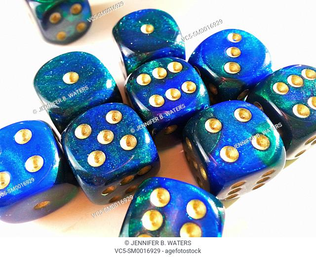 Close-up of colorful blue dice on a white background