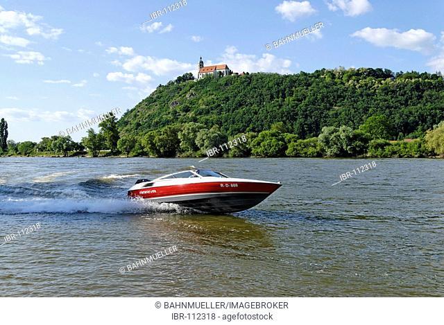 Sportsboat on the river Danube below the pilgrimage church Bogenberg Lower Bavaria Germany MR