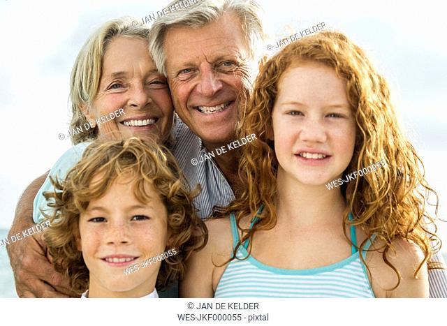 Spain, Portrait of grandparents and grandchildren, smiling