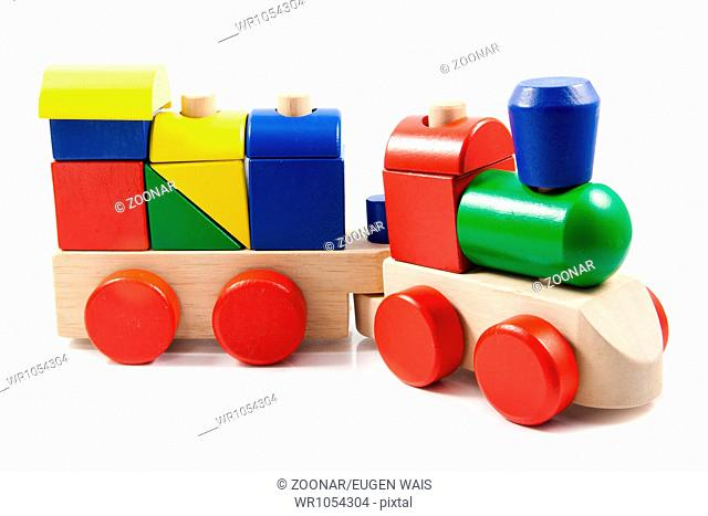 Colorful wooden toy train isolated on white backgr