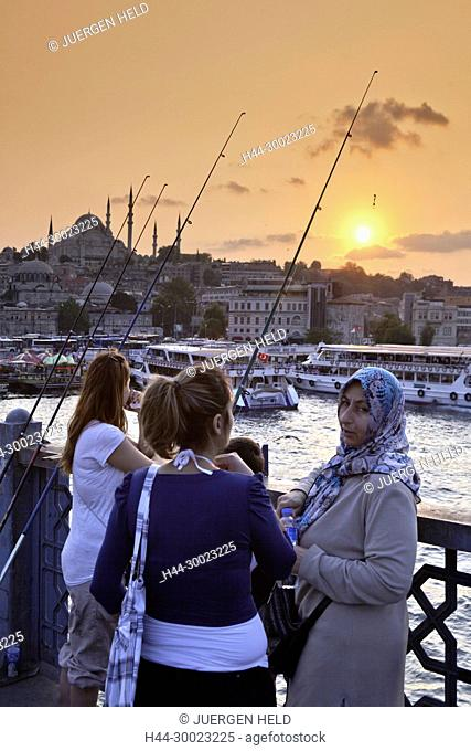 Galata bridge at Golden Horn , Fisherman on the bridge, Istanbul, Turkey , Europe