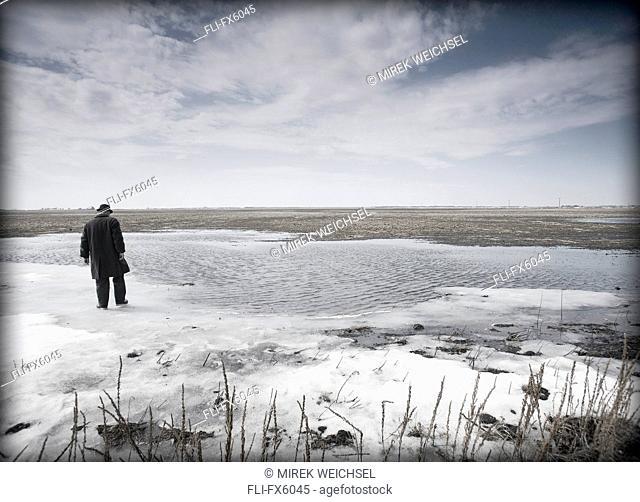 Man Standing in Field in Winter, Winnipeg, Manitoba