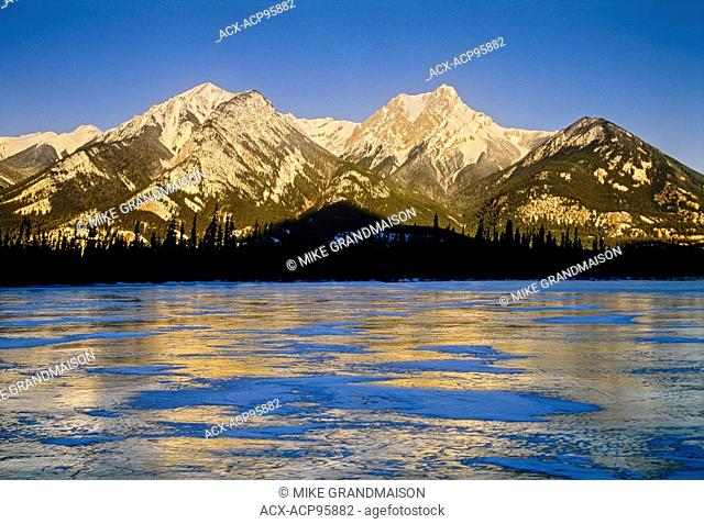 Jasper Lake in early morning light and Canadian Rocky Mountains Jasper National Park Alberta Canada