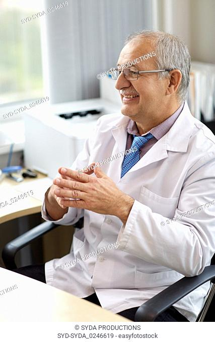 happy smiling doctor at medical office in hospital