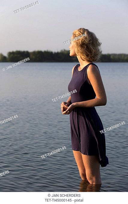 Beautiful woman standing in lake