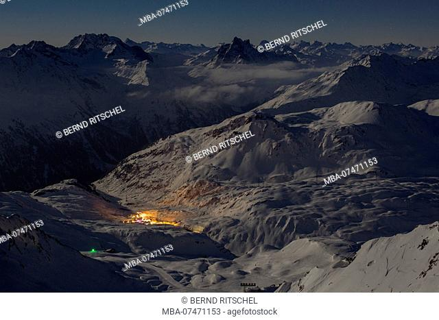 View from the Valluga to St. Christoph in the valley at dusk, ski area St. Anton am Arlberg, Lechtaler Alps, Tyrol, Austria