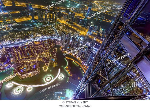 United Arab Emirates, Dubai, Fountain in the Burj Khalifa Lake with Souk Al Bahar seen from the Burj Khalifa at night