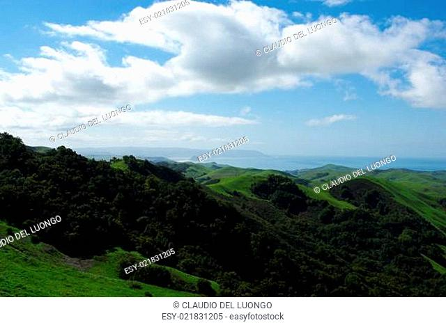 Green hills and Pacific Ocean with Morro Bay, California