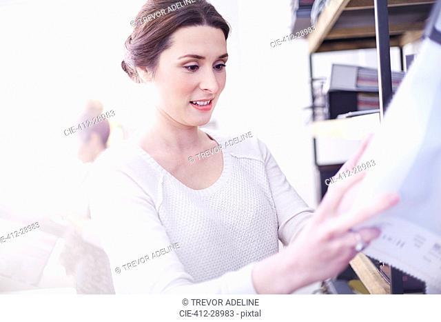 Interior designer browsing fabric swatches