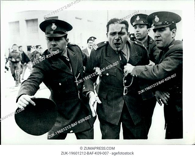 Dec. 12, 1960 - Anti-Government demonstrations in Athens injured policeman helped away: There was serious anti-Government demonstrations in the streets of...