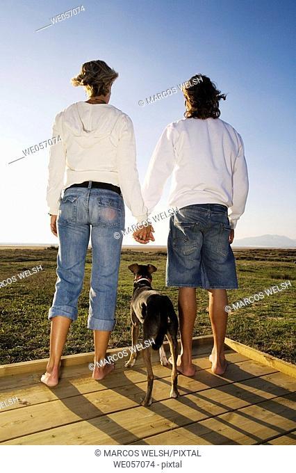 Couple With Their Dog Enjoying Scenery