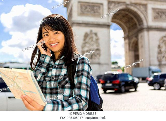 View of a Young attractive asian tourist visiting Paris