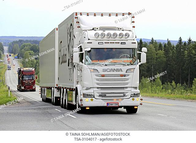 IKAALINEN, FINLAND - AUGUST 9, 2018: White Scania R freight truck Starfly customized with light accessories in truck convoy to Power Truck Show 2018