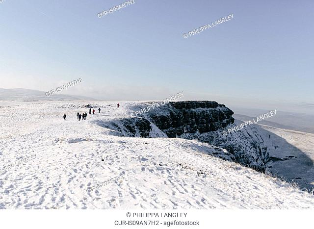 Hikers in distance, Llyn y Fan Fach, Brecon Beacons, Wales