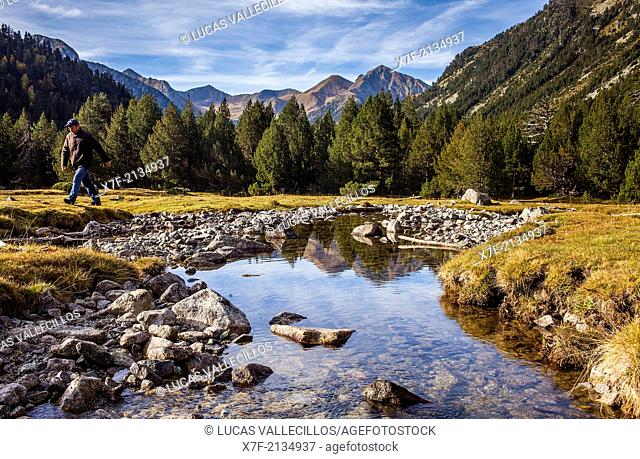 Hiker.Aigüestortes area,Aigüestortes i Estany de Sant Maurici National Park,Pyrenees, Lleida province, Catalonia, Spain