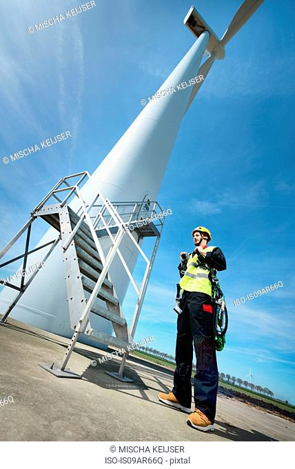 Maintenance worker preparing for work at a modern wind turbine, Biddinghuizen, Flevoland, Netherlands