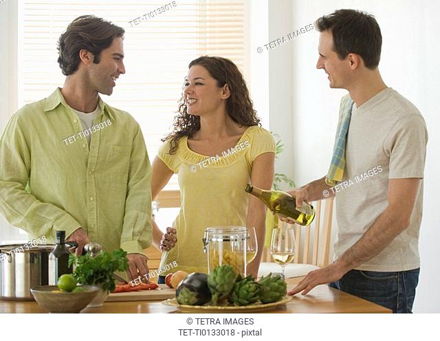 Friends preparing meal in kitchen