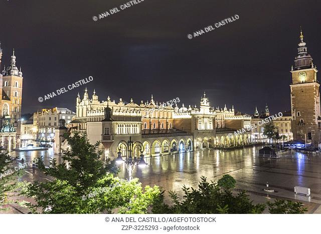 KRAKOW POLAND ON SEPTEMBER 23, 2018: Aerial view of The main square by night in the Old Town of Krakow with the town hall tower, Lesser Poland