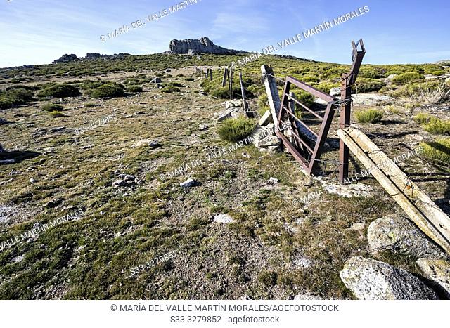 Fence at Sierra Paramera and Graja cliff on the background. Avila. Spain. Europe