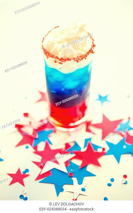 american independence day, celebration, patriotism and holidays concept - glass of cocklatil drink with whipped cream and stars confetti decoration on american...