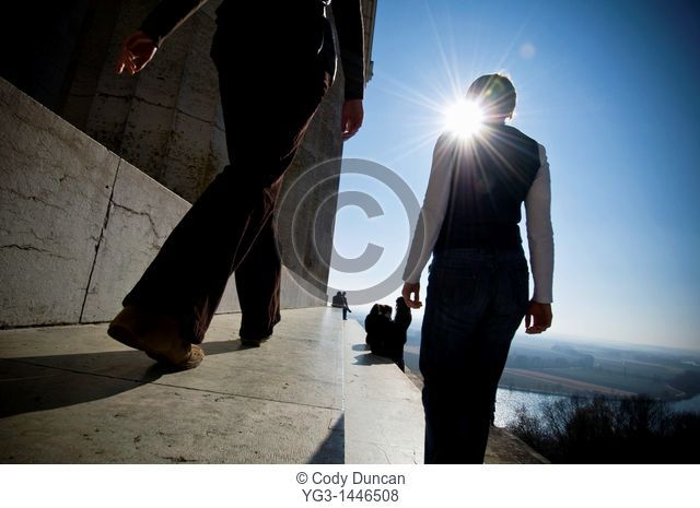 Two women walking along steps of Walhalla temple with Danube river in background, Regensburg, Germany