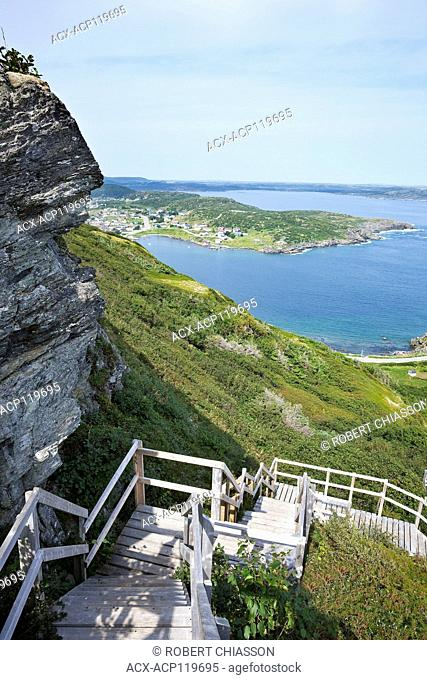 St. Anthony Harbour and the Town of St. Anthony as seen from Daredevil Hill, St. Anthony, Newfoundland, Canada. The steps in the foreground are a section of the...
