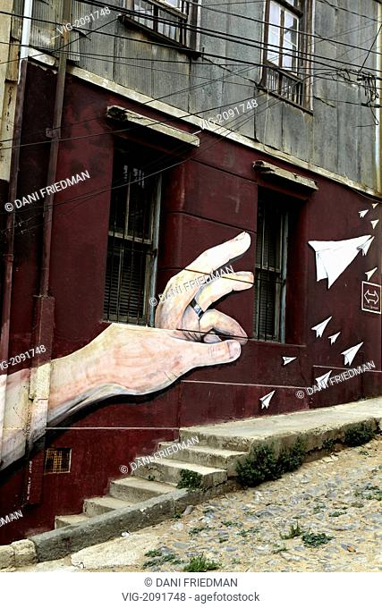 A mural of a left hand wearing a wedding band and throwing paper airplanes on a wall in Valparaiso. - VALPARAISO, VALPARAISO, CHILE, 10/03/2010