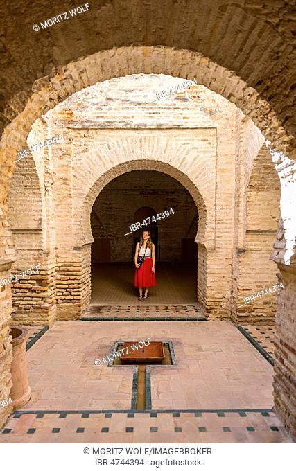 Woman with red dress, Arab baths, Alcázar de Jerez, Jerez de la Frontera, Cádiz province, Andalusia, Spain
