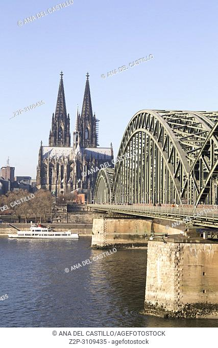 The Hohenzollern Bridge (German: Hohenzollernbrücke) is a bridge crossing the river Rhine in the German city of Cologne . Germany