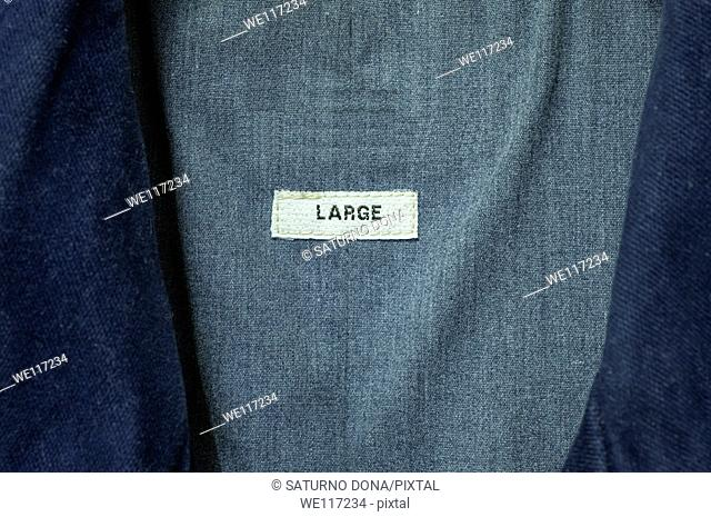 Label with Large Size inside a Casual Coat