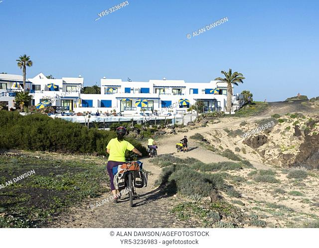 Three female cyclists tourng the island by mountain bike. Lanzarote, Canary Islands, Spain