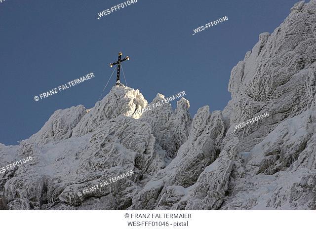 Germany, Bavaria, Kampenwand, Cross on mountain top
