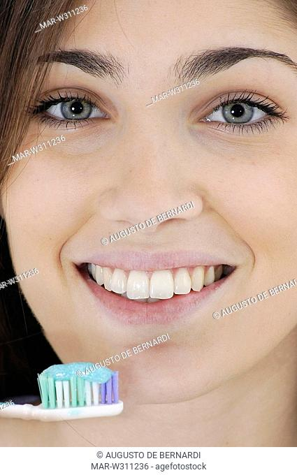 young woman, toothbrush