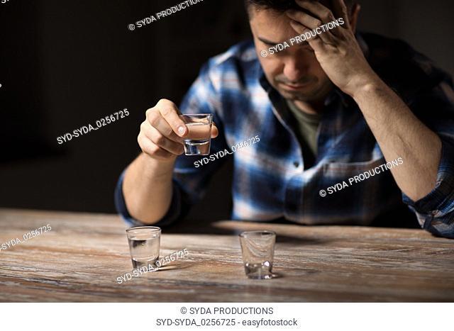 man drinking alcohol at night