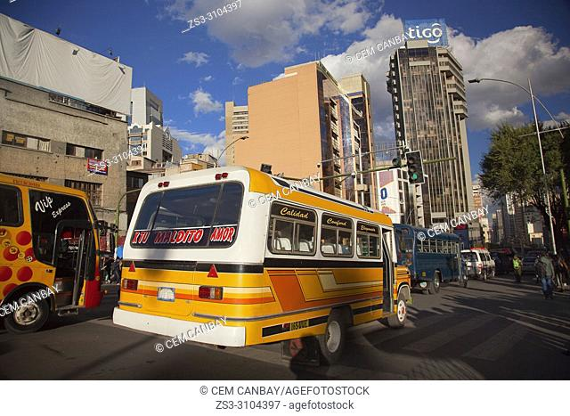 View to the modern buildings and local buses at Plaza San Francisco Square at the historic center, La Paz, Bolivia, South America