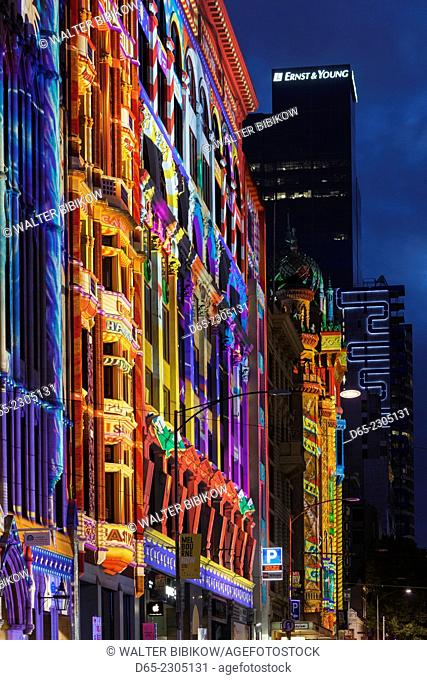 Australia, Victoria, VIC, Melbourne, White Nights Festival, buildings lit with projected laser designs, buildings along Flinders Street