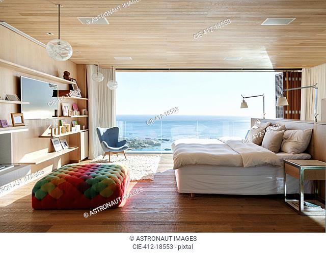 Sunny bedroom with ocean view
