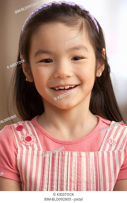 Smiling mixed race girl